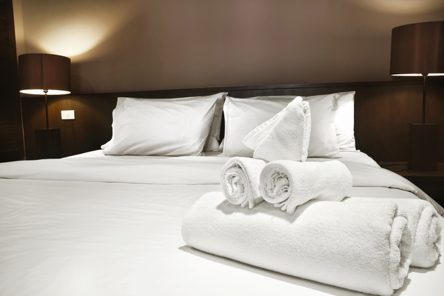 white towels prepared on bed