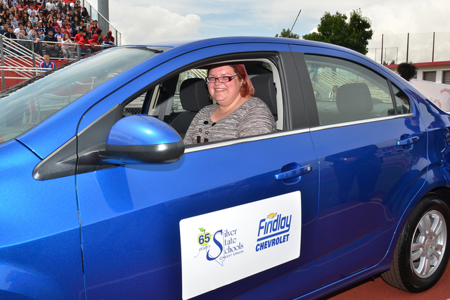 COURTESY Valley High School teacher Jamie Tadrzynski sits in her 2016 Chevrolet Sonic LT Turbo sedan presented to her May 6, capping Teacher Appreciation Week. The vehicle was donated by Findlay C ...