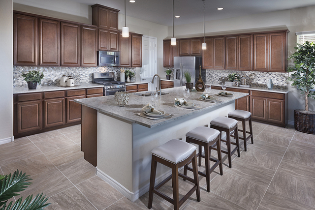 COURTESY One of the six model home kitchens at Heritage. This home is 2,495 square feet and includes a private suite.