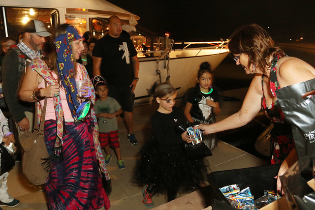 Courtesy Children receive treats last year at Lake Las Vegas.