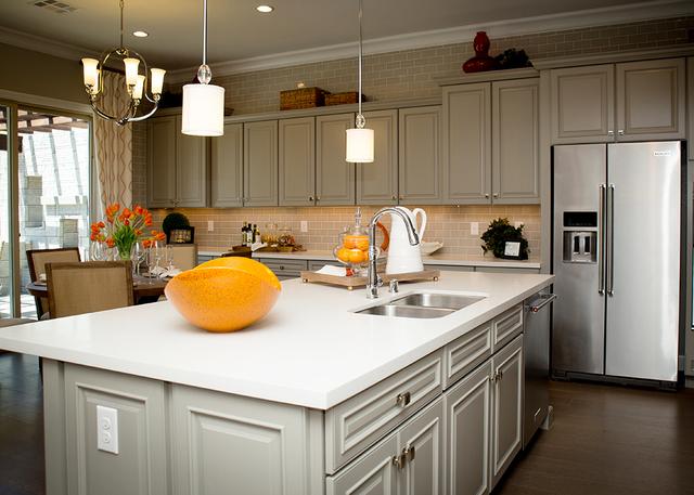 This kitchen showcases a large island with seating.  (TONYA HARVEY/RJRealEstate.Vegas)