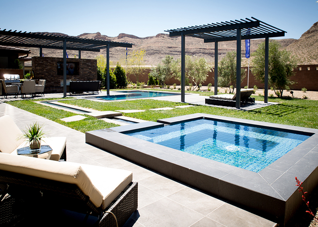 This backyard is designed with the pool connected to the spa by a small stream of water. (TONYA HARVEY/RJRealEstate.Vegas)