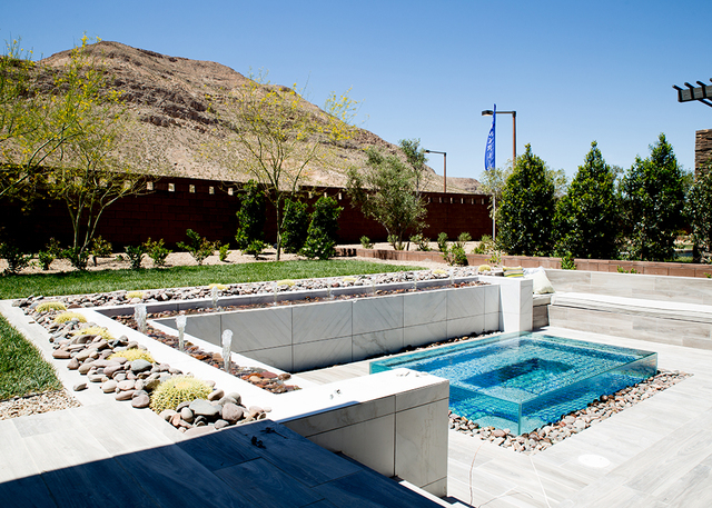 This Regency model showcases a water feature in the backyard. (TONYA HARVEY/RJRealEstate.Vegas)