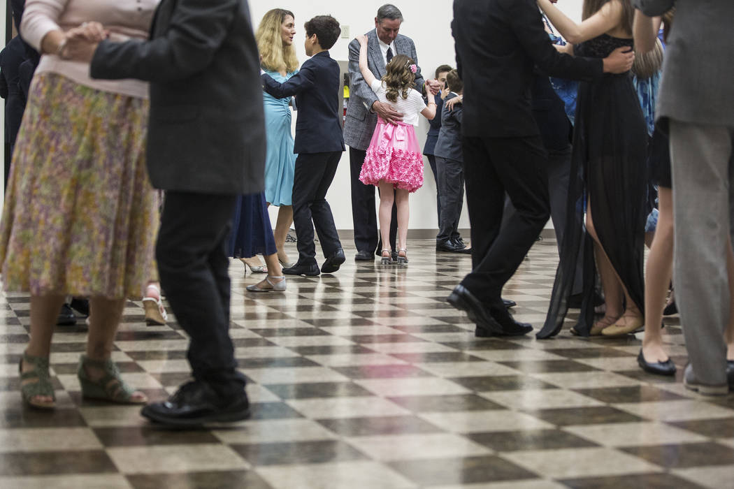 Keanu Stanton dances with father Chuck Stanton during the last night of Summerlin Cotillion on Saturday, April 1, 2017, at Vistas Community Center, in Las Vegas. Summerlin Cotillion is in its 4th  ...