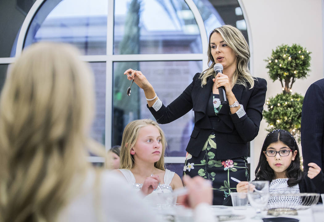 Instructor Annabel Kyler, middle, discusses the proper placement of utensils during Summerlin Cotillion on Saturday, March  4, 2017, at Vistas Community Center, in Las Vegas. Summerlin Cotillion i ...