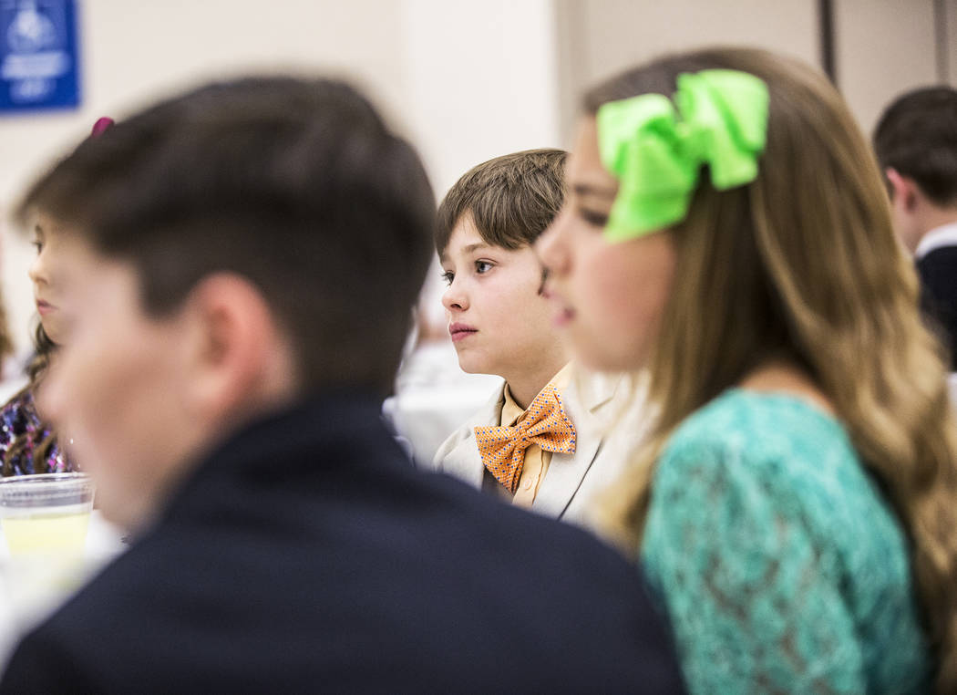 Charles Tharin, middle, listens to instruction on dinning etiquette during Summerlin Cotillion class on Saturday, March 4, 2017,  at Vistas Community Center, in Las Vegas. Summerlin Cotillion is i ...