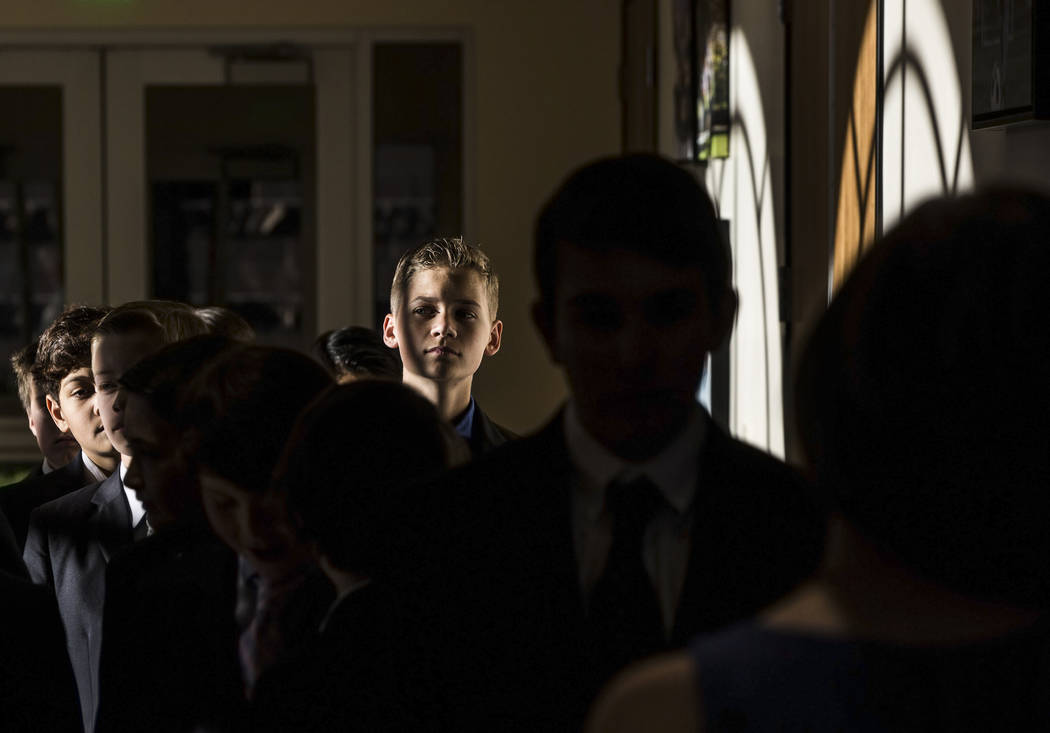 The line for 6-8th grade boys waiting to greet their dates spills into the hallway during Summerlin Cotillion on Saturday, April 1, 2017,  at Vistas Community Center, in Las Vegas. Summerlin Cotil ...