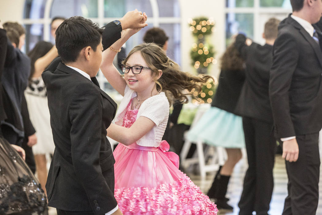Keanu Stanton, middle, is spun by her partner while practicing the Foxtrot during the final day of Summerlin Cotillion on Saturday, April 1, 2017, at Vistas Community Center, in Las Vegas. Summerl ...