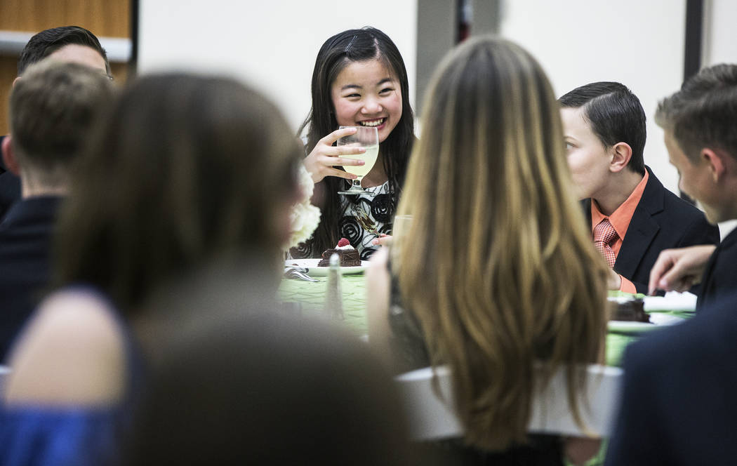 Myah Gordan, middle, shares a laugh with her classmates  during dinning etiquette class at Summerlin Cotillion on Saturday, April 1, 2017, at Vistas Community Center, in Las Vegas. Summerlin Cotil ...