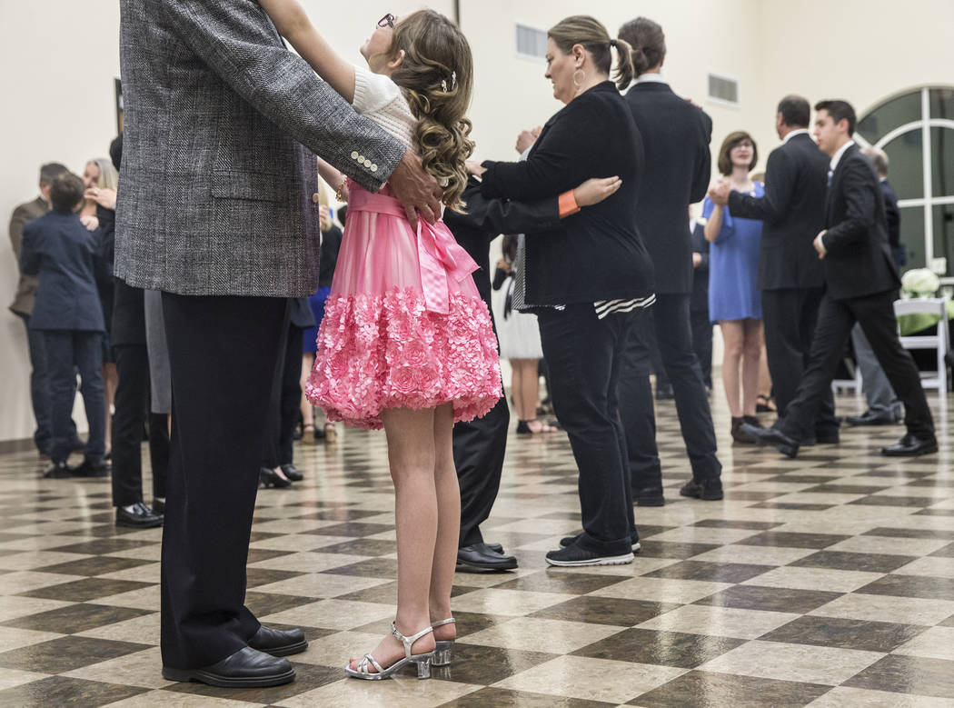 Keanu Stanton, left/middle, dances with her father Chuck Stanton during the final night of Summerlin Cotillion on Saturday, April 1, 2017, at Vistas Community Center, in Las Vegas. Summerlin Cotil ...