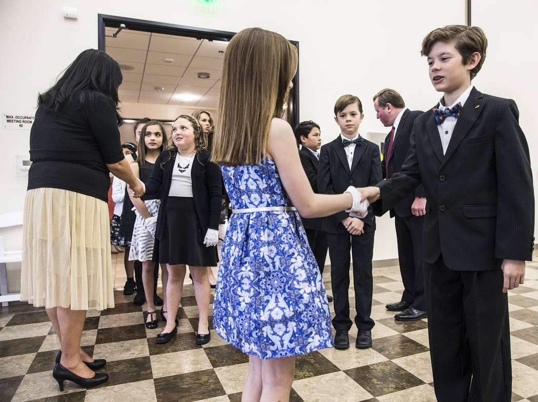 Students greet their dates during Summerlin Cotillion on Saturday, March 18, 2017, at Vistas Community Center, in Las Vegas. Summerlin Cotillion is in its 4th year in Las Vegas, providing children ...