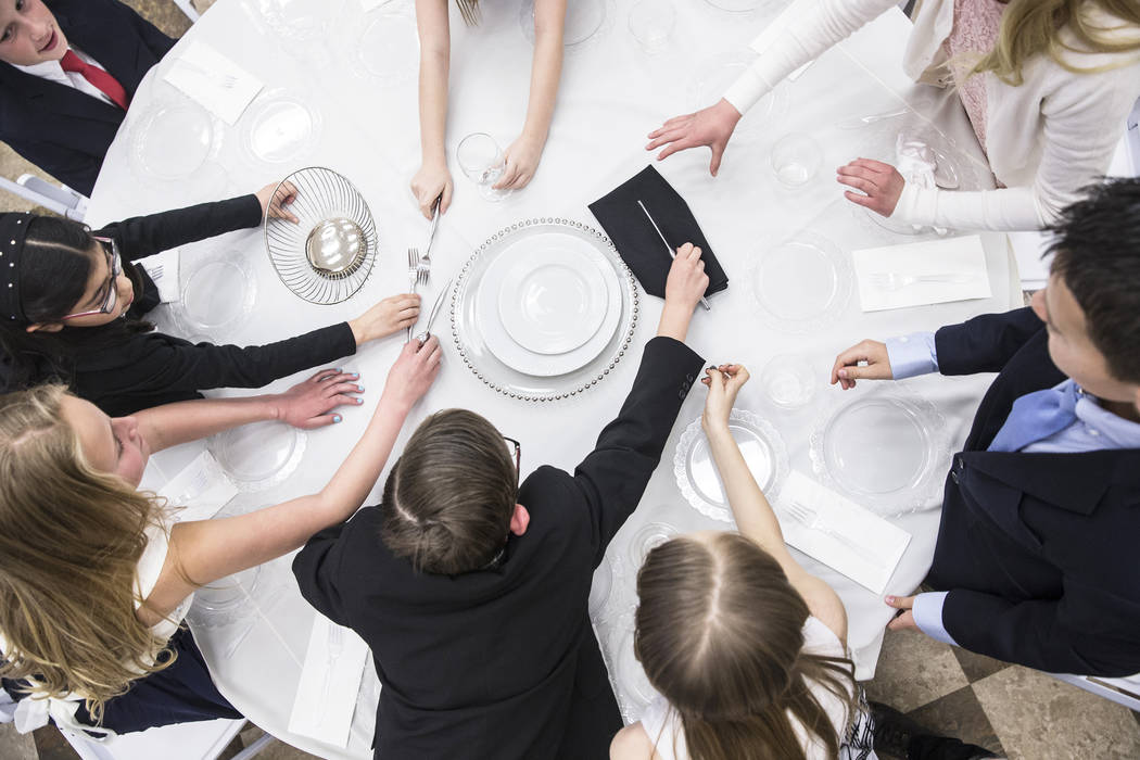 Students in the 4th grade class work on a table setting exercise during Summerlin Cotillion on Saturday, March 4, 2017, at Vistas Community Center, in Las Vegas. Summerlin Cotillion is in its 4th  ...