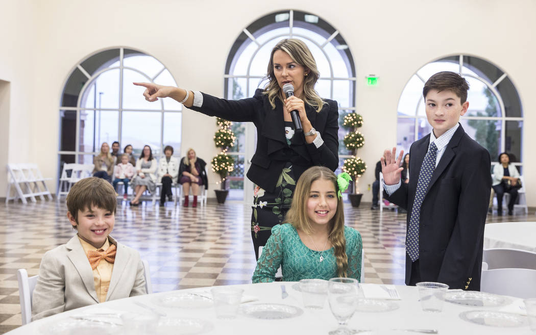 Instructor Annabel Kyler, middle, discusses table etiquette during Summerlin Cotillion on Saturday, March 4, 2017,  at Vistas Community Center, in Las Vegas. Summerlin Cotillion is in its 4th year ...