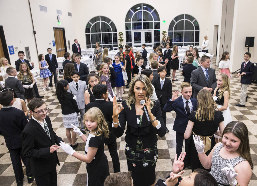 Instructor Annabel Kyler, middle, teaches 4th grade students to Foxtrot during Summerlin Cotillion on Saturday, March 4, 2017, at Vistas Community Center, in Las Vegas. Summerlin Cotillion is in i ...