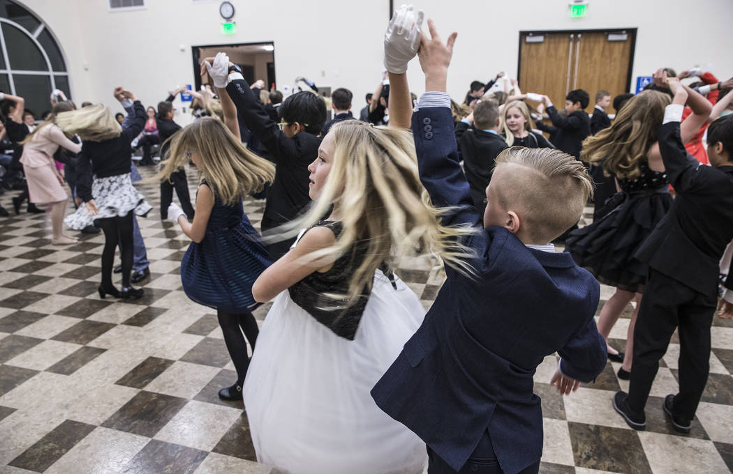 Brynlie Hannig, left, dances with Lennon Wever during Summerlin Cotillion on Saturday, March 4, 2017, at Vistas Community Center, in Las Vegas. Summerlin Cotillion is in its 4th year in Las Vegas, ...