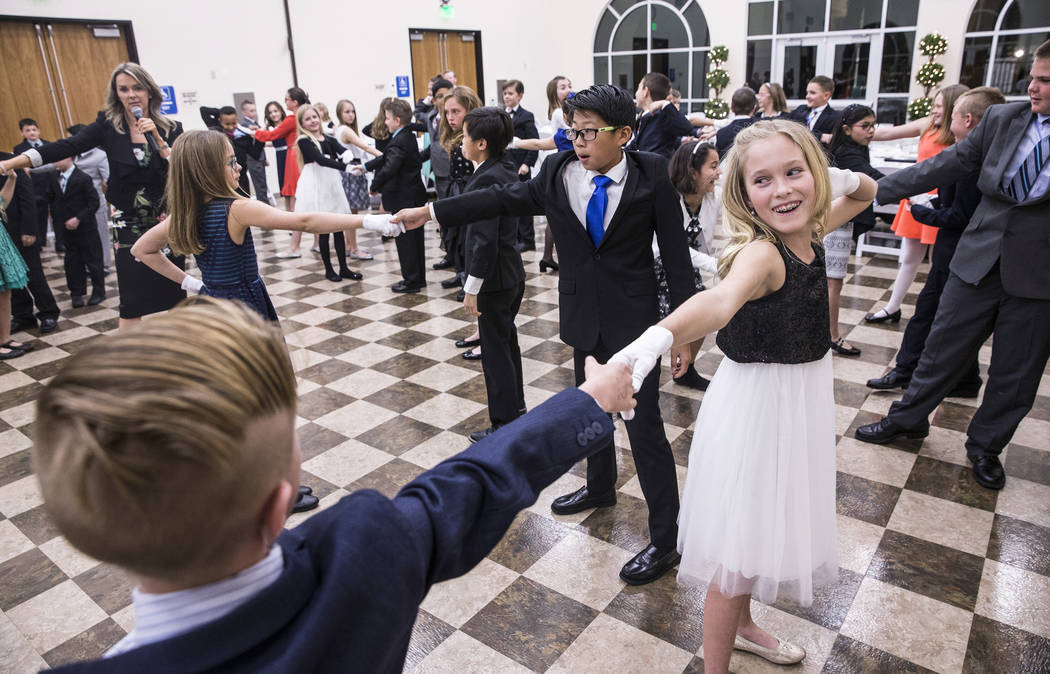Brynlie Hannig, right, dances with Lennon Wever during Summerlin Cotillion on Saturday, March 4, 2017, at Vistas Community Center, in Las Vegas. Summerlin Cotillion is in its 4th year in Las Vegas ...