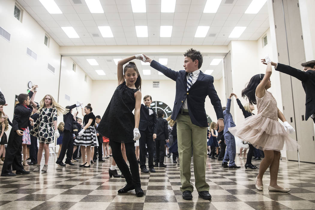 Students practice dancing during the final night of Summerlin Cotillion on Saturday, April 1, 2017, at Vistas Community Center, in Las Vegas. Summerlin Cotillion is in its 4th year in Las Vegas, p ...
