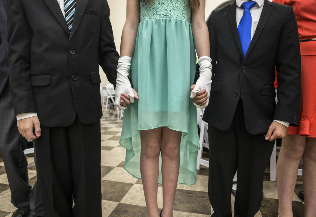 Students hold hands while listening to instructions on how to Foxtrot during Summerlin Cotillion on Saturday, March 4, 2017, in Las Vegas. Summerlin Cotillion is in its 4th year in Las Vegas, prov ...