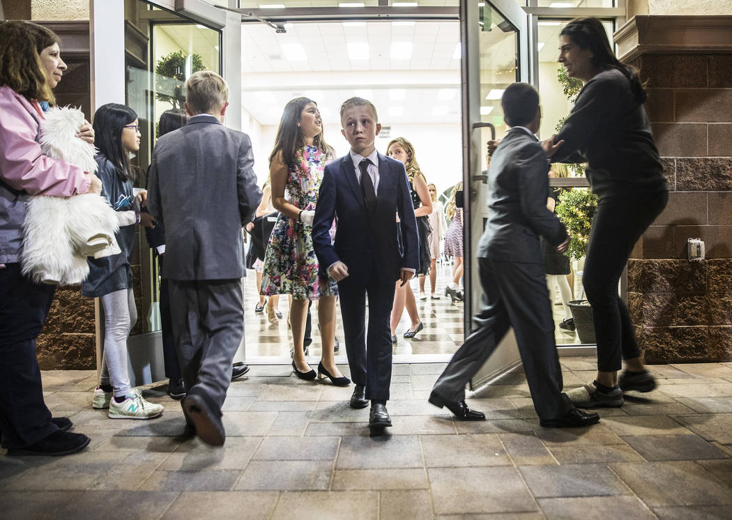 Lennon Wever walks out of the Vistas Community Center at the end of Summerlin Cotillion class on Saturday, March 4, 2017, in Las Vegas. Summerlin Cotillion is in its 4th year in Las Vegas, providi ...