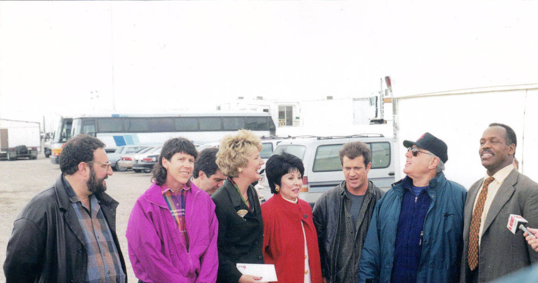 "Robin Holabird, second from left, along with then-Lt. Gov. Lorraine Hunt, fourth from left, meet with with Mel Gibson and Danny Glover, far right, during the shooting in Las Vegas of ""Lethal Weapo ..."