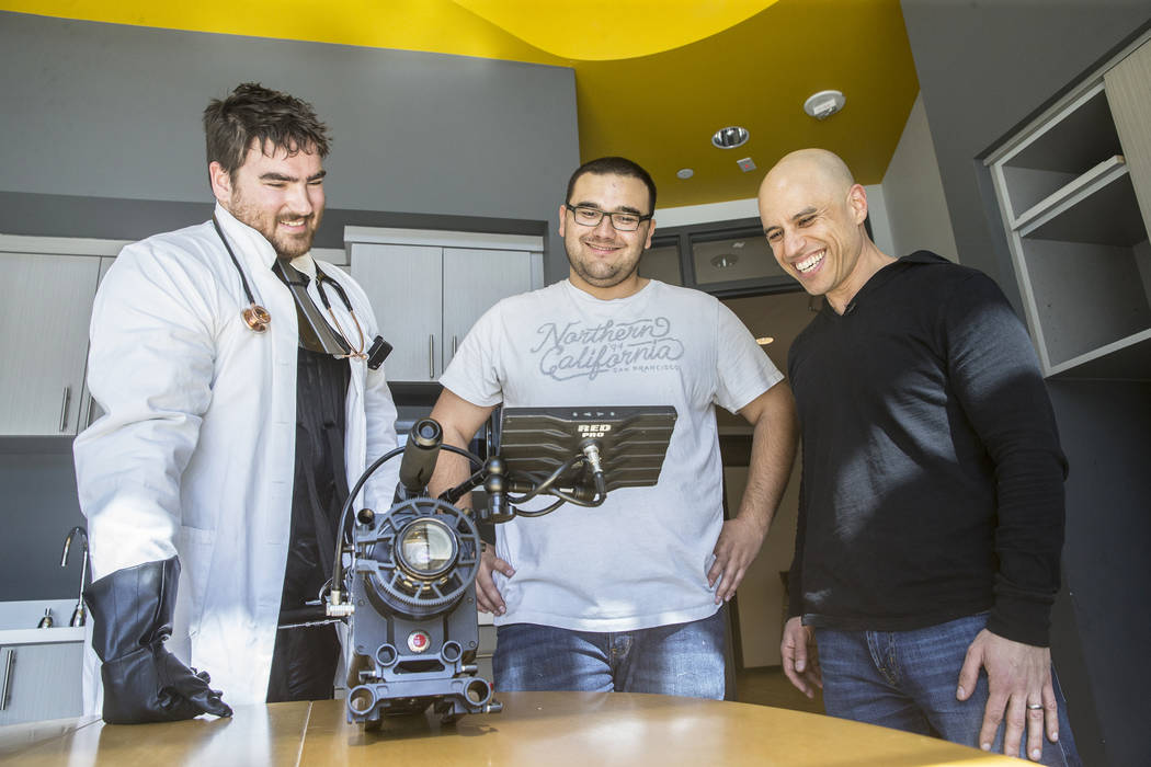 "Director Tom Hinueber, left, cinematographer Logan Stewart and Dr. Zubin Damania, AKA ""ZDoggMD,""  watch footage for an upcoming episode of ""Doc Vader"" at Turntable Health on Wednesday, March 8, 20 ..."