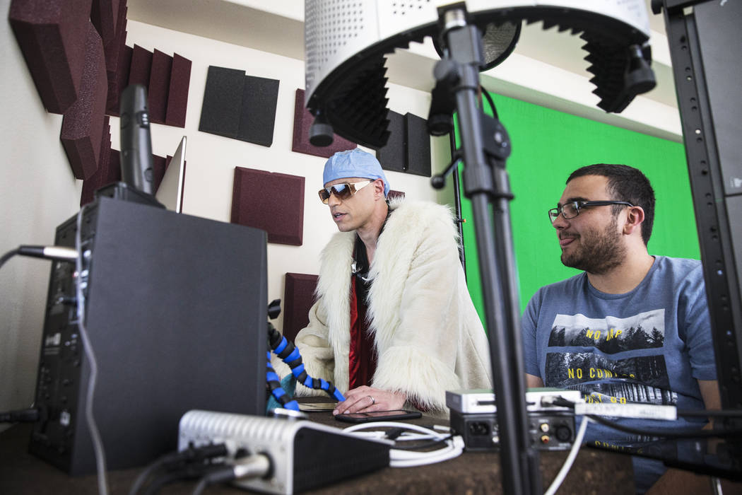"""Dr. Zubin Damania, AKA """"ZDoggMD,"""" and Cinematographer Logan Stewart watch footage from Damania's Facebook Live medical advice show on Sunday, March 19, 2017, at his studio, in La ..."""