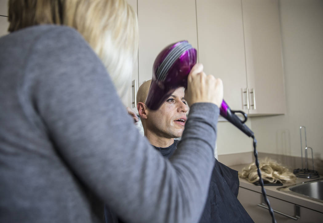 """Dr. Zubin Damania, AKA """"ZDoggMD,"""" gets his makeup done by Lindsey Dimick before filming a scene parodying Kesha's hit song 'Tik Tok' on Sunday, April 9, 2017, at Damania's studio ..."""