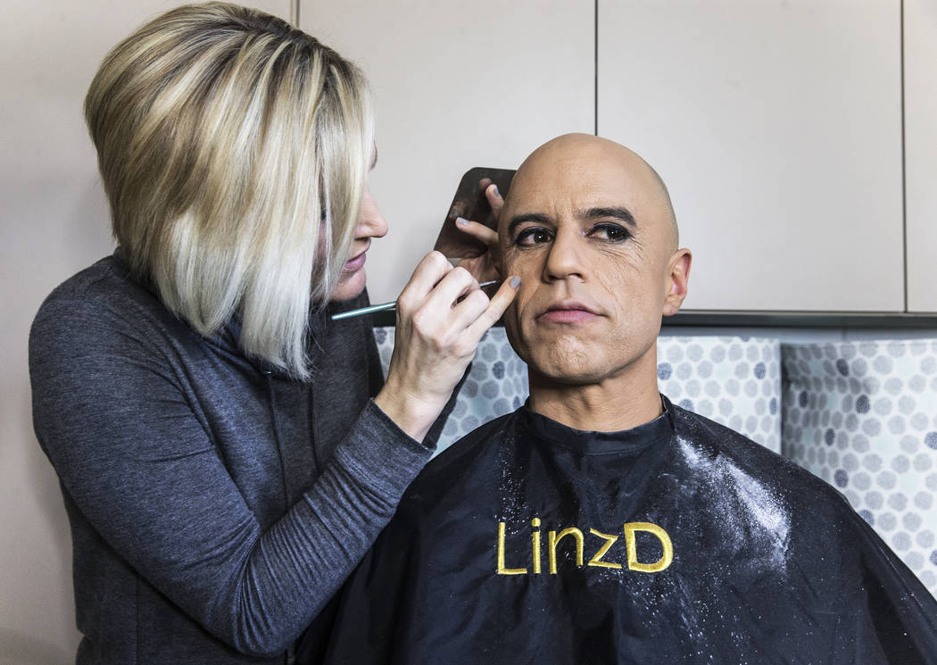 "Dr. Zubin Damania, AKA ""ZDoggMD,"" right, gets his makeup done by Lindsey Dimick before filming a scene parodying Kesha's hit song 'Tik Tok' on Sunday, April 9, 2017, at Damania's ..."