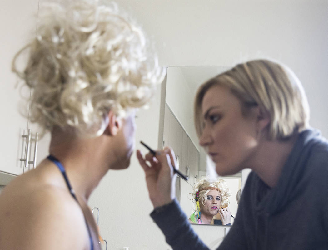 """Dr. Zubin Damania, AKA """"ZDoggMD,"""" left, gets his makeup done by Lindsey Dimick before filming a scene parodying Kesha's hit song 'Tik Tok' on Sunday, April 9, 2017, at Damania's  ..."""
