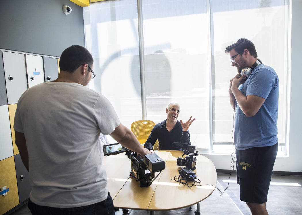 "Cinematographer Logan Stewart, left, Dr. Zubin Damania, AKA ""ZDoggMD,"" and director Tom Hinueber walk through a scene in an upcoming episode of ""Doc Vader"" at T ..."