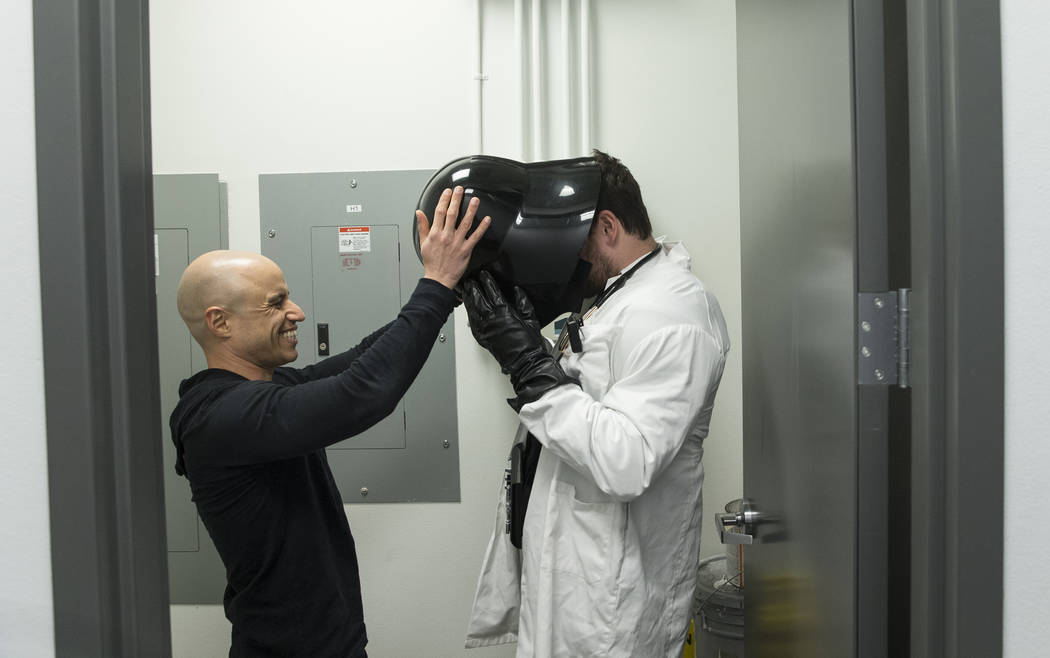 """Dr. Zubin Damania, AKA """"ZDoggMD,"""" left, helps actor/director Tom Hinueber get into costume to film an episode of """"Doc Vader"""" at Turntable Health on Wednesday, M ..."""