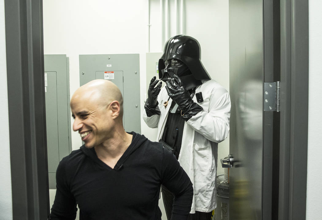 "Dr. Zubin Damania, AKA ""ZDoggMD,"" left, and actor/director Tom Hinueber get into costume to film an episode of ""Doc Vader"" at Turntable Health on Wednesday, Mar ..."