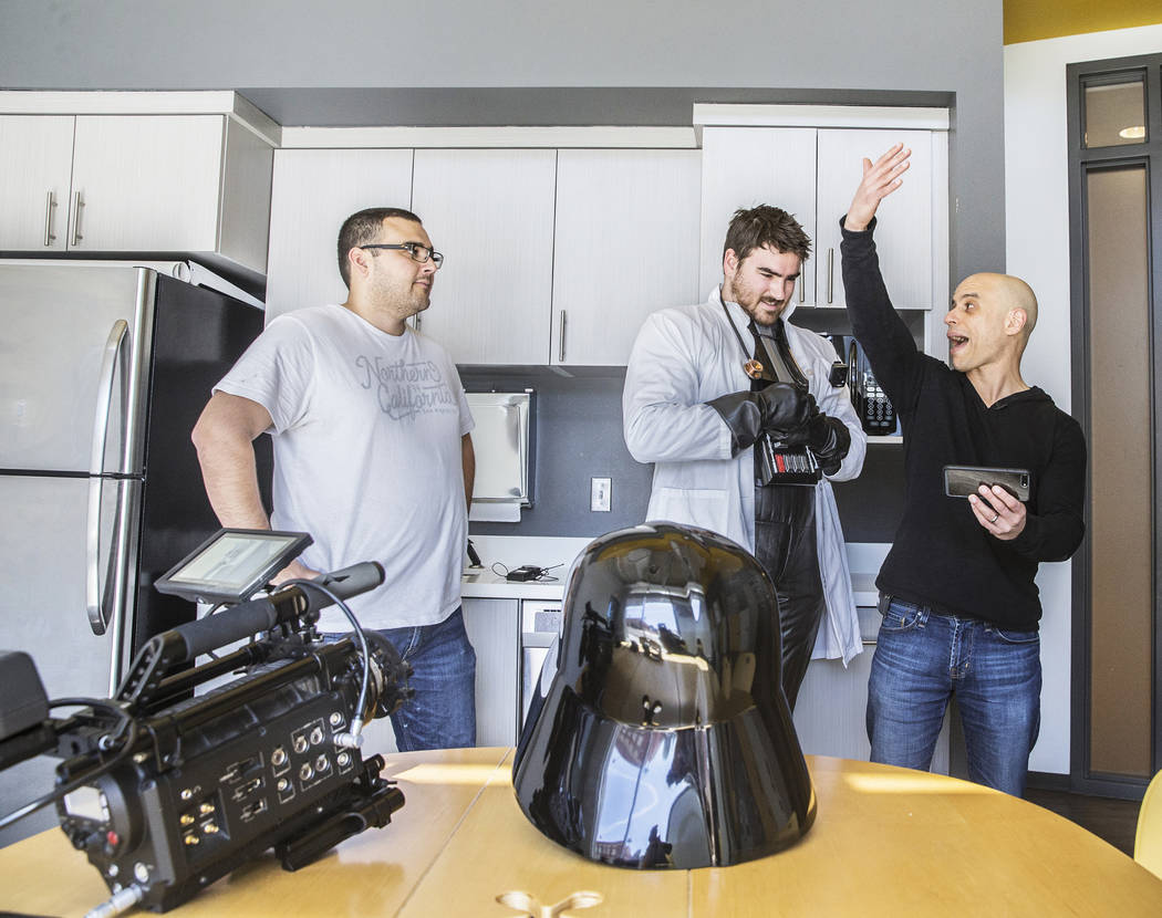 "Cinematographer Logan Stewart, left, actor/director Tom Hinueber and Dr. Zubin Damania, AKA ""ZDoggMD,"" walk through a scene for an upcoming episode of ""Doc Vader"" at Turntable Health on Wednesday, ..."