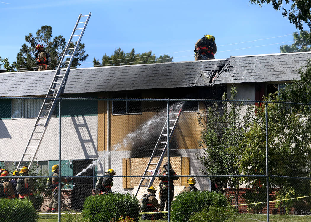 Clark County firefighters battle a fire at 741 and 743 Greenbriar Townhouse Way in Las Vegas on Wednesday, May 3, 2017. (Bizuayehu Tesfaye/Las Vegas Review-Journal) @bizutesfaye