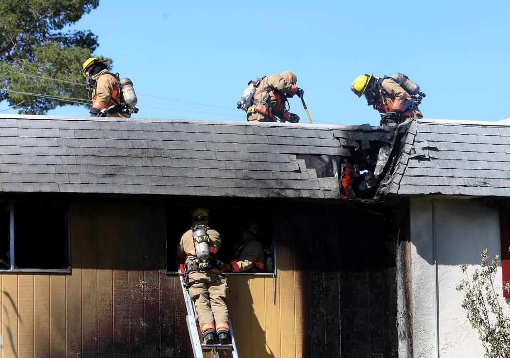 Clark County firefighters battle a fire at 741 and 743 Greenbriar Townhouse Way in Las Vegas on Wednesday, May 3, 2017. (Bizuayehu Tesfaye/Las Vegas Review-Journal) @bizutesfaye