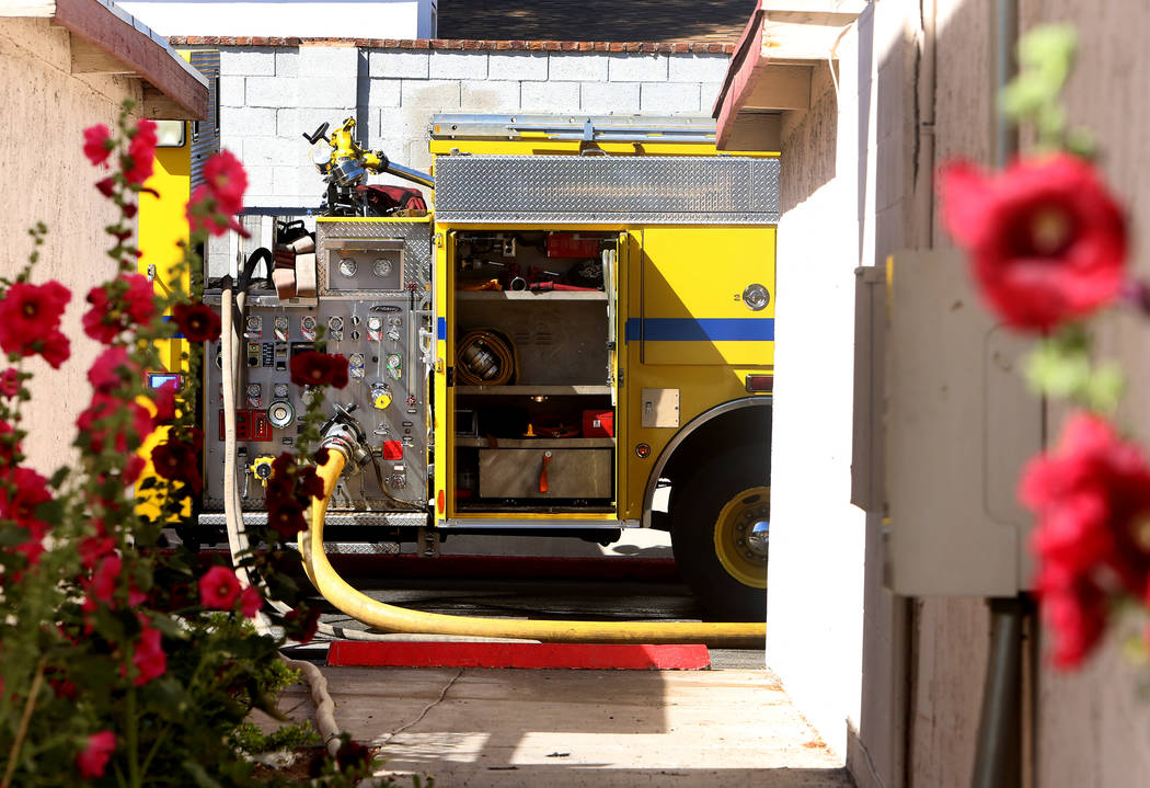 Clark County fire truck oitside 741 and 743 Greenbriar Townhouse Way where firefighters battle a fire in Las Vegas on Wednesday, May 3, 2017. (Bizuayehu Tesfaye/Las Vegas Review-Journal) @bizutesfaye