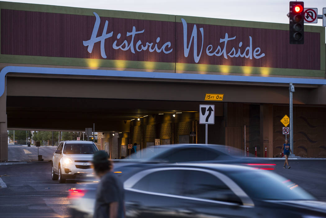 Cars and pedestrians move along Bonanza Road near the Historic Westside sign above F Street in Las Vegas on Wednesday, April 26, 2017. Chase Stevens Las Vegas Review-Journal @csstevensphoto