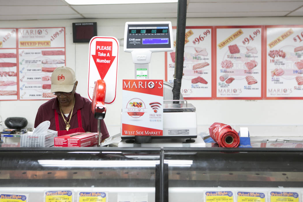 Employee Clovis Moore works behind the meat counter at Mario's Westside Market on Wednesday, April 26, 2017, in Las Vegas. Bridget Bennett Las Vegas Review-Journal @bridgetkbennett