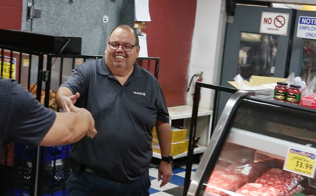Owner of Mario's Westside Market Mario Berlanga Jr. greets a customer at his store on April 14, 2017 in Las Vegas. Bridget Bennett Las Vegas Review-Journal @bridgetkbennett