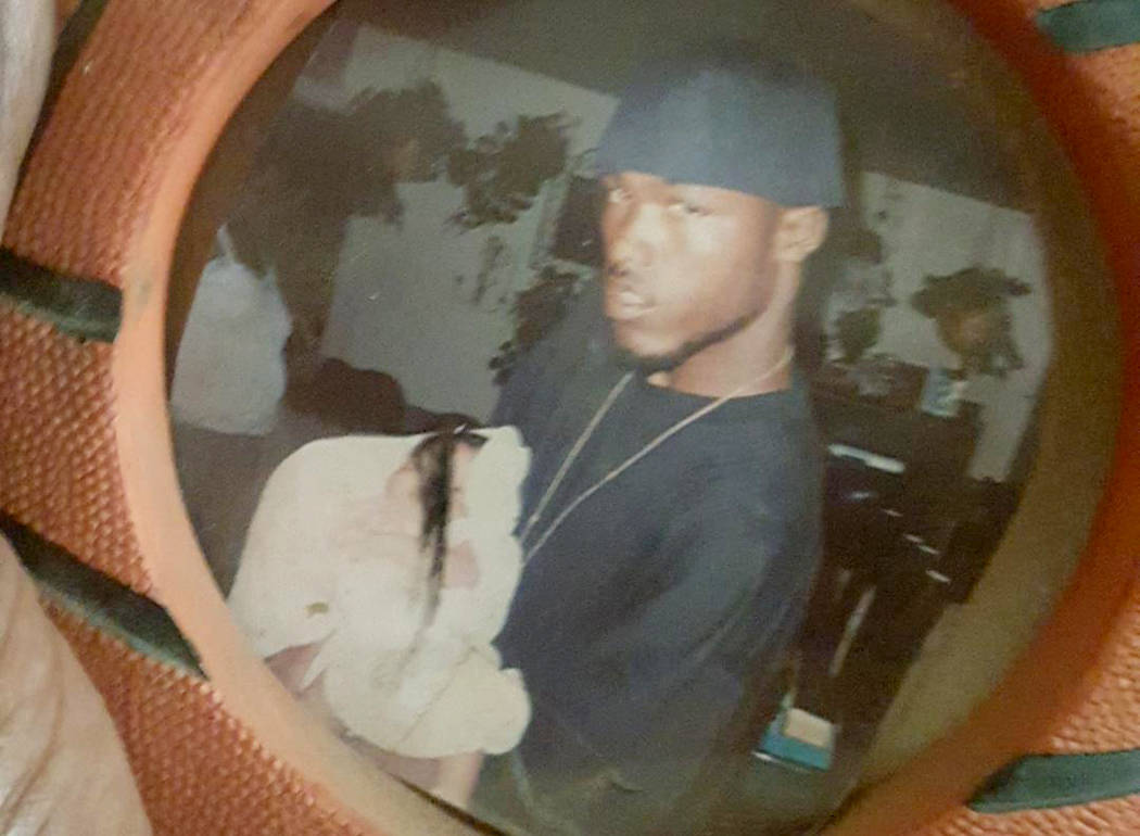 Jemar Matthews, as a teenager, holding his son. Photo provided by Tasha Page