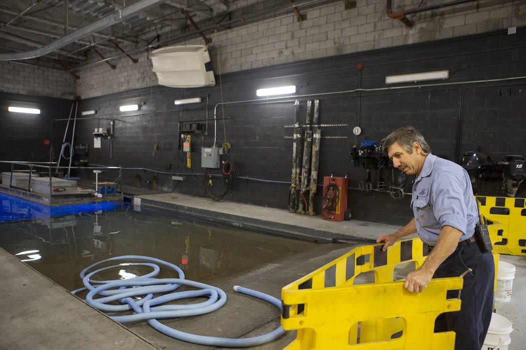 """Fountains of Bellagio engineer Rod Botelho extends a cautionary barrier in a maintenance area, nicknamed the """"Batcave,""""Tuesday, April 18, 2017, at Bellagio hotel-casino in Las Ve ..."""