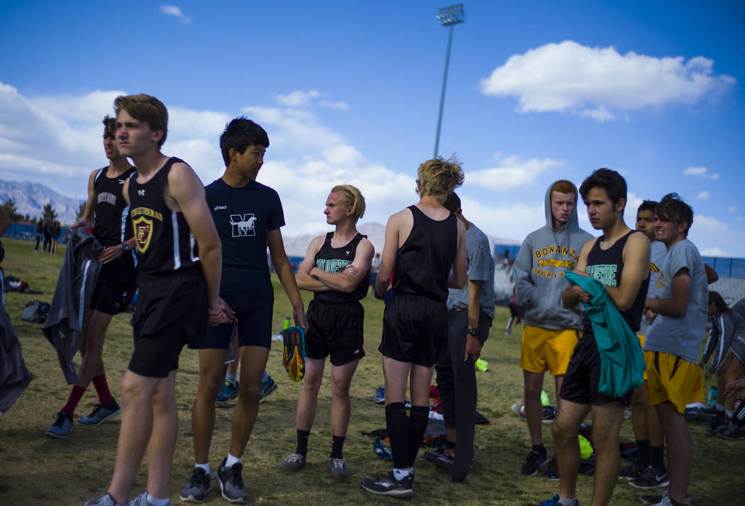 Palo Verde's Ben Slighting, fourth from left, waits to check in for the 1600-meter run during a track and field meet at Centennial High School in Las Vegas on Friday, April 28, 2017. Chase Stevens ...