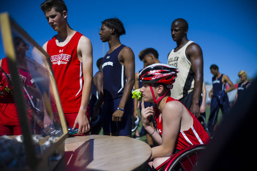 Arbor View freshman Blake Dickinson checks in before competing in the 100-meter dash during a track and field meet at Arbor View High School in Las Vegas on Wednesday, April 19, 2017. Chase Steven ...