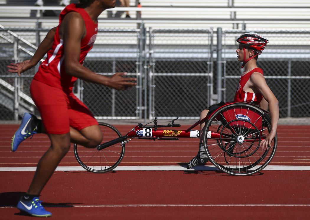 Arbor View freshman Blake Dickinson, right, between events during a track and field meet at Arbor View High School in Las Vegas on Wednesday, April 19, 2017. Chase Stevens Las Vegas Review-Journal ...