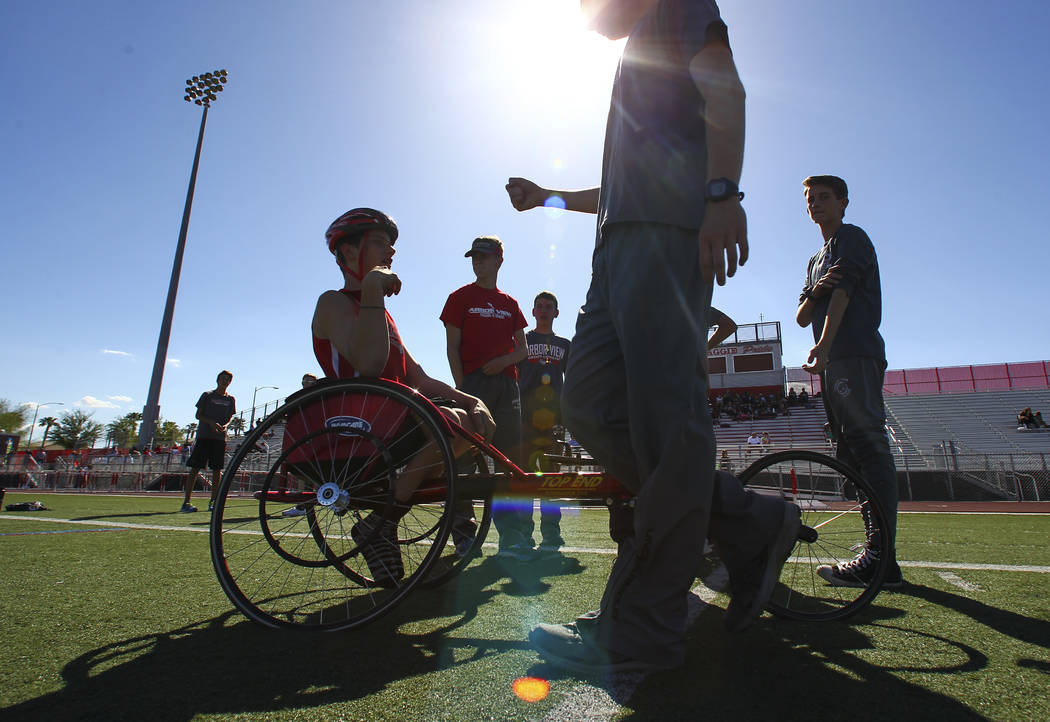 Arbor View freshman Blake Dickinson greets a teammate before competing in the 100-meter dash during a track and field meet at Arbor View High School in Las Vegas on Wednesday, April 19, 2017. Chas ...