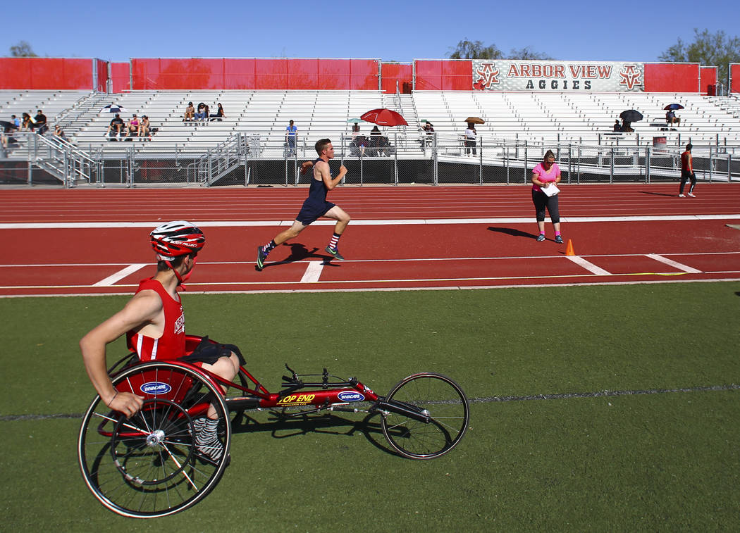 Arbor View freshman Blake Dickinson, left, between events during a track and field meet at Arbor View High School in Las Vegas on Wednesday, April 19, 2017. Chase Stevens Las Vegas Review-Journal  ...