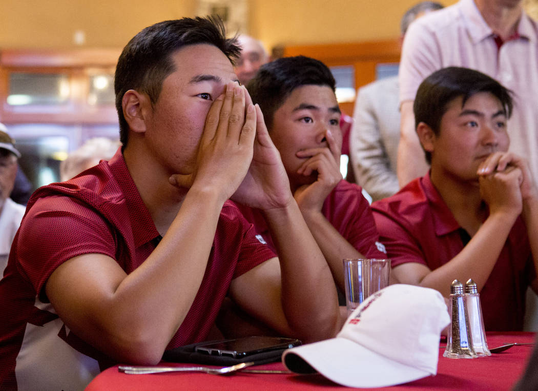 UNLV golfers, from left, Justin Kim, Shintaro Ban and John Oda wait to hear where they will be selected to play for the NCAA 2017 men's regionals at the Las Vegas Country Club in Las Vegas, Thursd ...