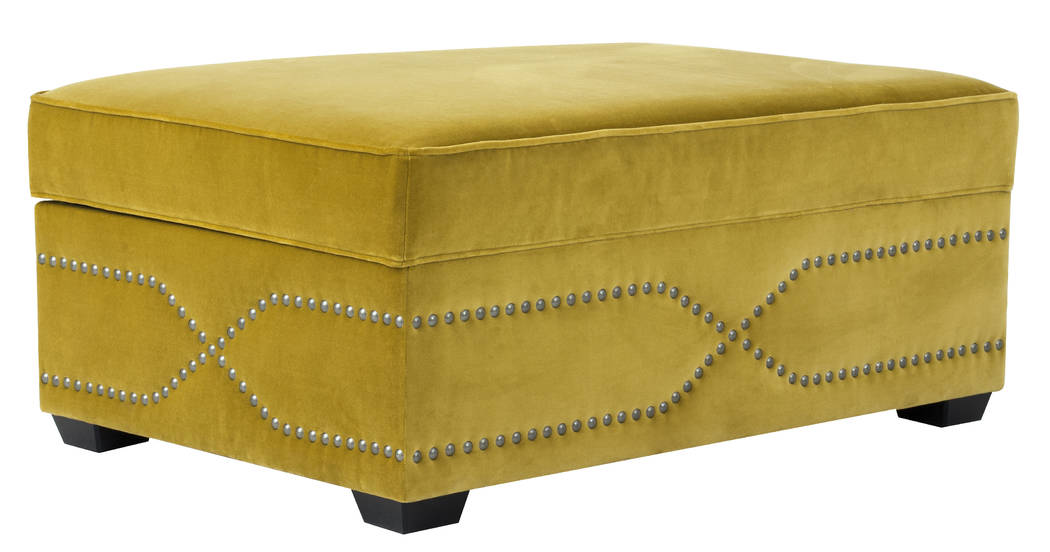 Norwalk Furniture The Monterey sleeper ottoman is a generously sized, fully upholstered cocktail ottoman with a beautiful nailhead design on all four sides, which opens into a comfortable bed