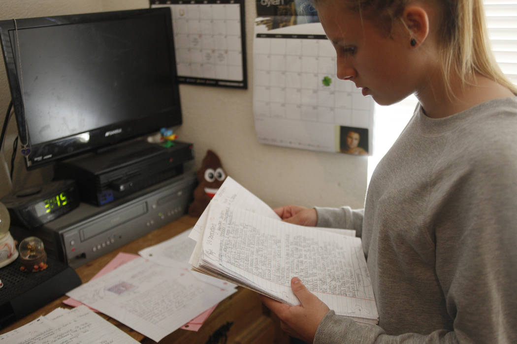 Kendra Jensen, 14, goes through classwork from her time in Jeffrey Schultz's class on Monday May 1, 2017, at her home in Henderson. Schultz was arrested in March on suspicion of indecency towards  ...