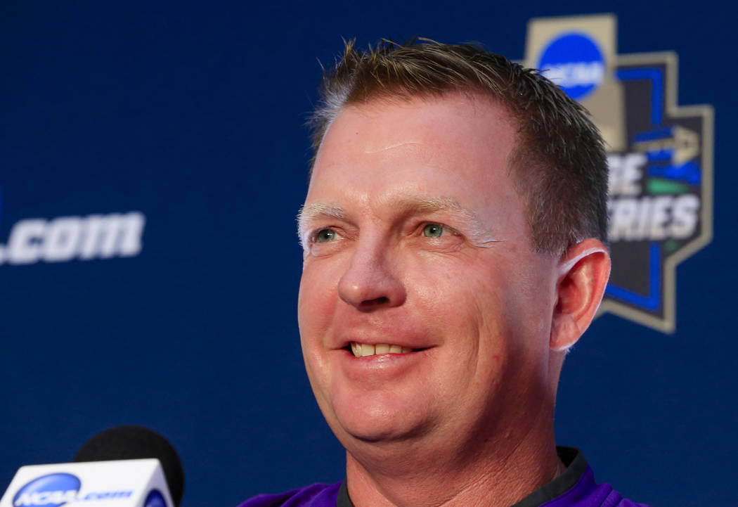 TCU coach Jim Schlossnagle smiles during a coaches' news conference at TD Ameritrade Park in Omaha, Neb., Friday, June 17, 2016, ahead of the NCAA men's baseball College World Series. TCU plays ag ...